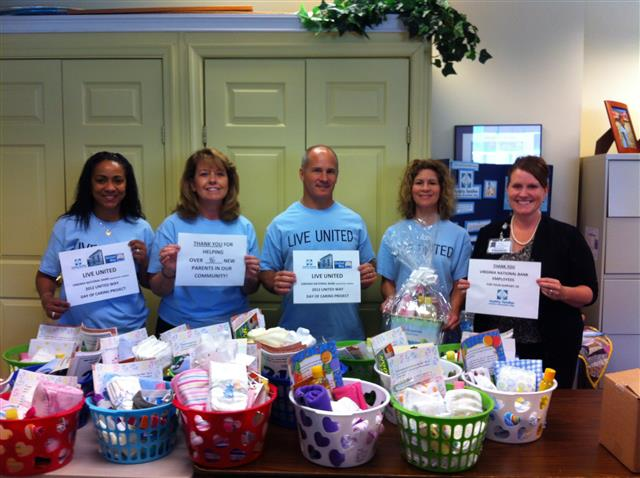 "2013 United Way ""Day of Caring"" Volunteers came and assembled many New Baby Care Packages for our community!"